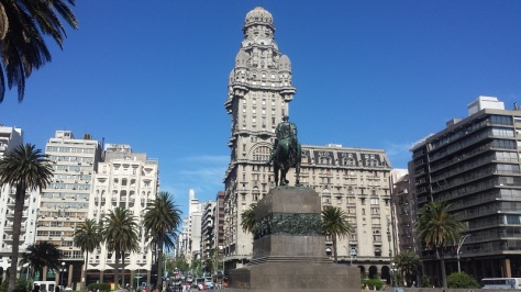 This is the photo that everyone takes of Montevideo's main square. It's always from the back view of the statue because that building is pretty. If you take a photo from the front of the statue the building behind it is an ugly, run-down, Soviet-looking monstrosity